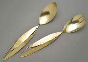 """Rivers"" pattern salad servers by Joy Raskin"